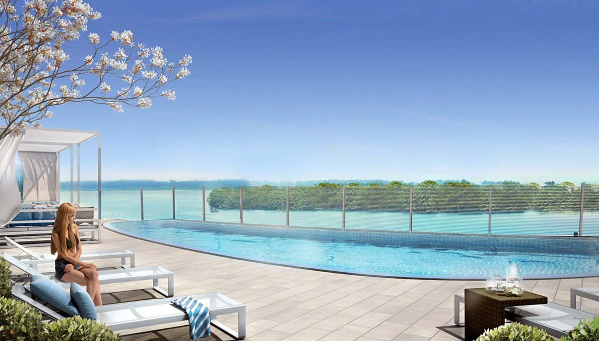 Outdoor pool and sun deck that overlook the harbour and feature private cabanas.